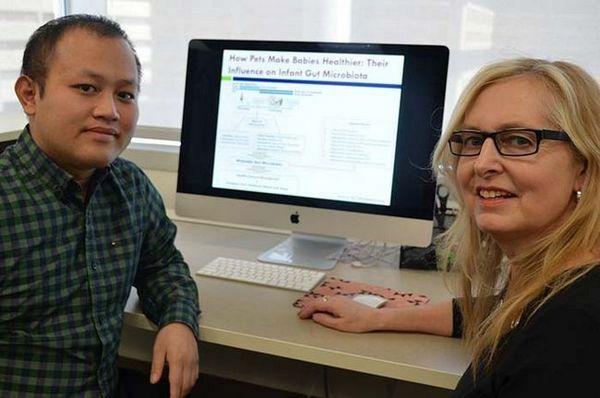 Cercetătorii Hein Min Tun și Anita Kozyrskyj - cercetări pentru copiii cu bacterii la câini